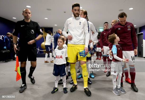 Captains Hugo Lloris of Tottenham Hotspur and Mark Noble of West Ham United line up in the tunnel with mascots and team mates prior to the Premier...