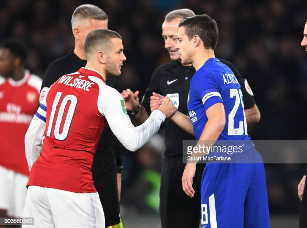 Captains Jack Wilshere of Arsenal and Cesar Azpilicueta of Chelsea before the Carabao Cup SemiFinal First Leg match between Chelsea and Arsenal at...