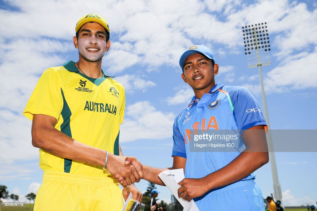 Captains Jason Sangha of Australia and Prithvi Shaw of India shake hands after the coin toss during the ICC U19 Cricket World Cup match between India and Australia at Bay Oval on January 14, 2018 in Tauranga, New Zealand.