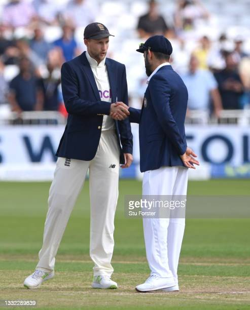 Captains Joe Root and Virat Kohli shake hands after the toss during day one of the First Test Match between England nd India at Trent Bridge on...