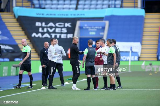 Captains Kasper Schmeichel of Leicester City and Ashley Westwood of Burnley meet with referee Lee Mason and his assistants ahead of the Premier...