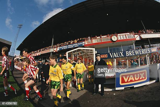 Captains Kevin Ball of Sunderland and Gavin Peacock of Newcastle United lead their teams out before a League Division One match between the sides at...