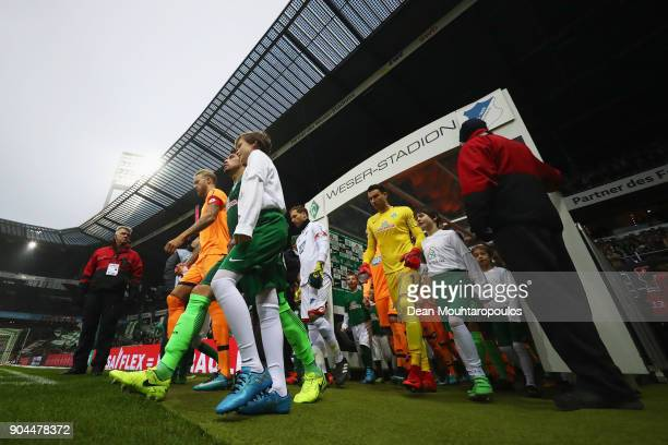 Captains Kevin Vogt of TSG 1899 Hoffenheim and Zlatko Junuzovic of Werder Bremen walk out of the players tunnel during the Bundesliga match between...
