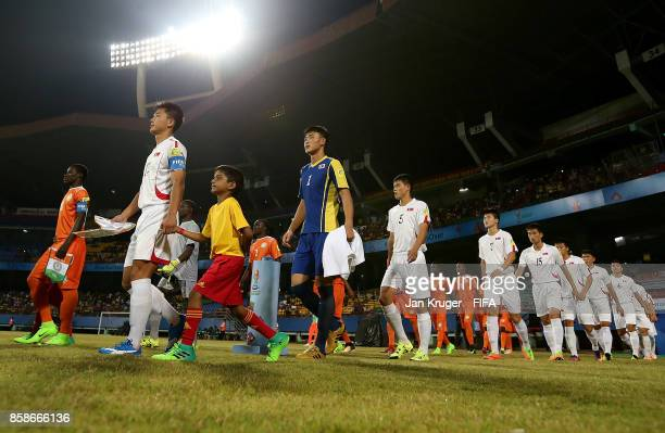 Captains lead their teams out during the FIFA U17 World Cup India 2017 group D match between Korea Republic and Niger at Jawaharlal Nehru...