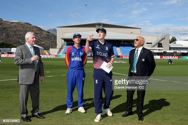 Captains Lohan Louwrens of Namibia and Harry Brook of England take part in the coin toss ahead of the ICC U19 Cricket World Cup match between England...