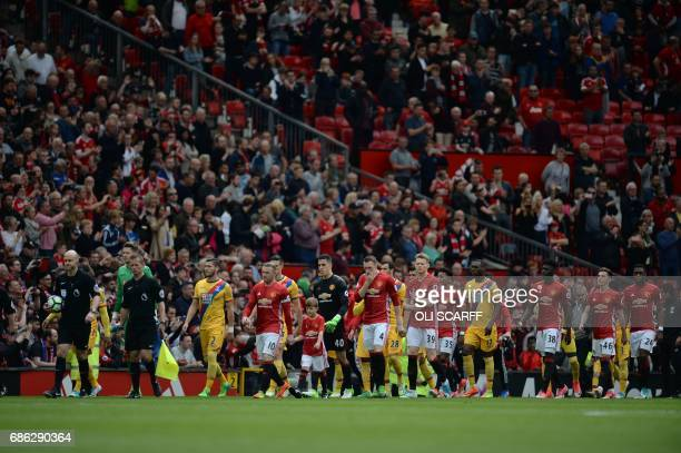 Captain's Manchester United's English striker Wayne Rooney and Crystal Palace's Welsh goalkeeper Wayne Hennessey lead their teams out for the English...