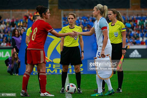 Captains Marta Torrejon of Spain and Stephanie Houghton of England shake hands prior to start the International Friendly match between Spain and...
