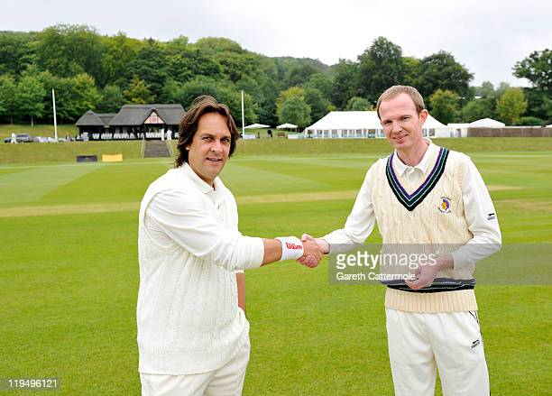 Captains Matt Butson and Richard Pitts shake hands prior to their match during an exclusive cricket day in the idyllic surroundings of the Getty...