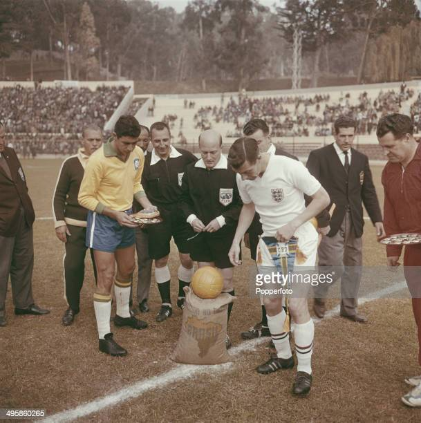 Captains Mauro Ramos of Brazil and Johnny Haynes of England exhange penants before kick off at the quarter final match between England and Brazil at...