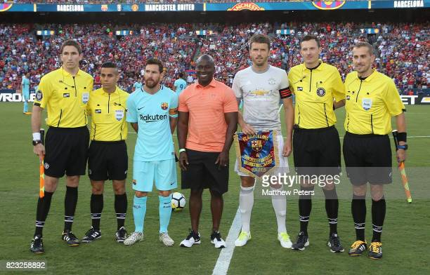 Captains Michael Carrick of Manchester United and Lionel Messi of Barcelona line up with the match officials ahead of the International Champions Cup...