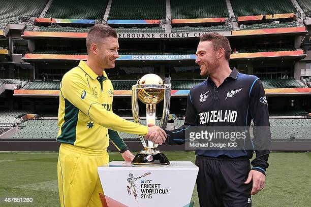 Captains Michael Clarke of Australia and Brendon McCullum of New Zealand shake hands in front of the World Cup trophy during the 2015 ICC Cricket...