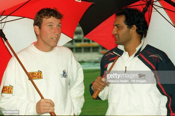 Captains Mike Atherton and Mohammad Azharuddin at the Oval after rain stopped play in the England v India oneday international * 3/11/2000 India...