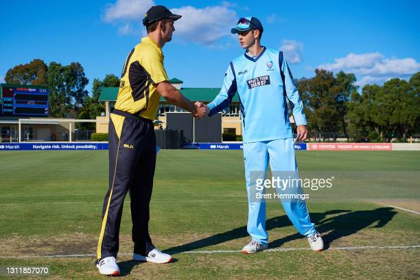 Captains Mitch Marsh of Western Australia and Curtis Patterson of NSW greet during the 2021 Marsh One Day Cup Final match between New South Wales and...