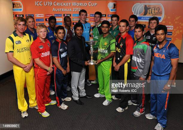 Captains of the 16 competing nations pose with the trophy during the ICC U19 Cricket World Cup 2012 opening function at Allan Border Field on August...