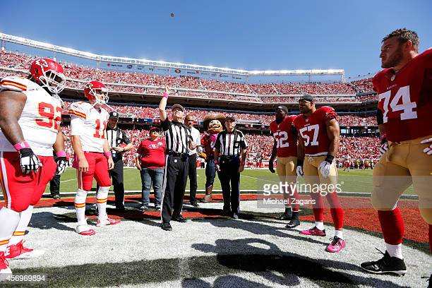 Captains of the San Francisco 49ers and the Kansas City Chiefs stand at center field for the coin flip prior to the game at Levi Stadium on October 5...