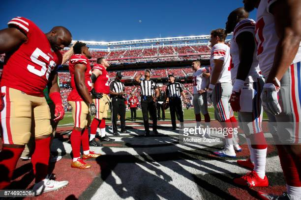 Captains of the San Francisco 49ers and the New York Giants meet at midfield for the coin toss prior to the game at Levi's Stadium on November 12...