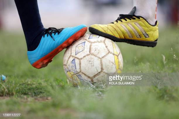 Captains of two football teams with a line-up of teams made up of Christians and Muslims, prepares to play a peace football final match aimed at...