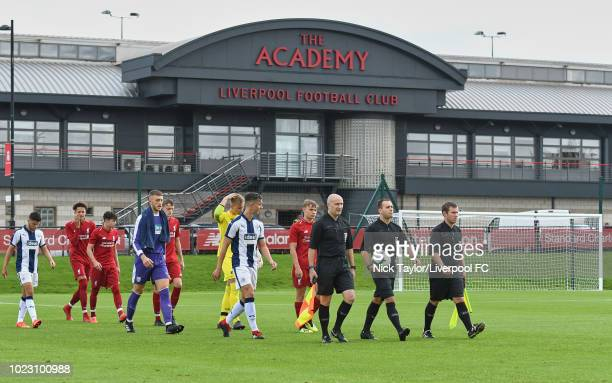 Captains Paul Glatzel of Liverpool and Pablo Martinez of West Bromwich Albion follow the match officials onto the pitch at the start of the Liverpool...