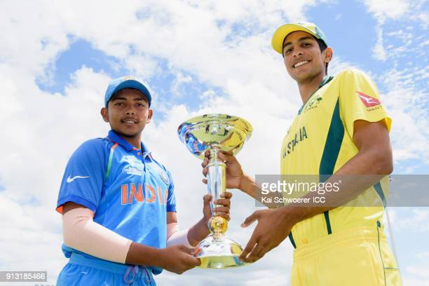 Captains Prithvi Shaw of India and Jason Sangha of Australia pose with the trophy during a prefinal media opportunity at Bay Oval on February 2 2018...