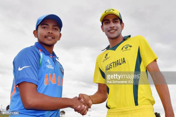 Captains Prithvi Shaw of India and Jason Sangha of Australia shake hands prior to the ICC U19 Cricket World Cup Final match between Australia and...