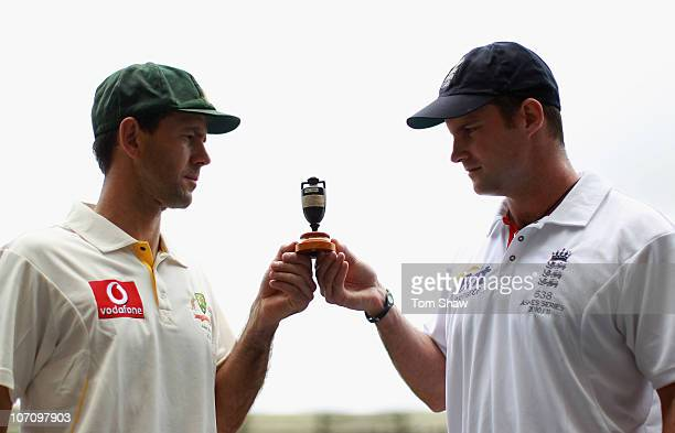 Captains Ricky Ponting of Australia and Andrew Strauss of England pose with a replica Ashes Urn during the England nets session at The Gabba on...