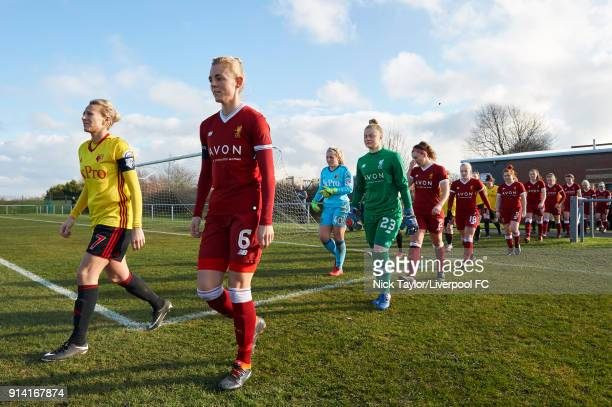 Captains Sophie Ingle of Liverpool Ladies and Anneka Nuttall of Watford Ladies lead their teams onto the pitch at the start of the Liverpool Ladies v...