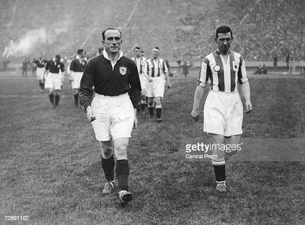 Captains Tom Parker and Tommy Wilson leading out Arsenal and Huddersfield Town for the FA Cup Final at Wembley 26th April 1930 Arsenal won the match...