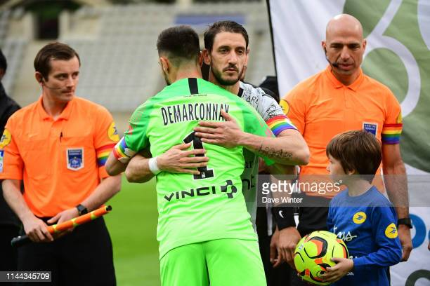 Captains Vincent Demarconnay of Paris FC and Jean Baptiste Pierazzi of Gazelec Ajaccio with antihomophobia rainbow armbands greet each other before...