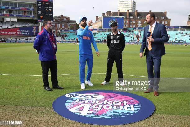 Captains Virat Kohli of India and Kane Williamson of New Zealand at the coin toss during the ICC Cricket World Cup 2019 Warm Up match between India...