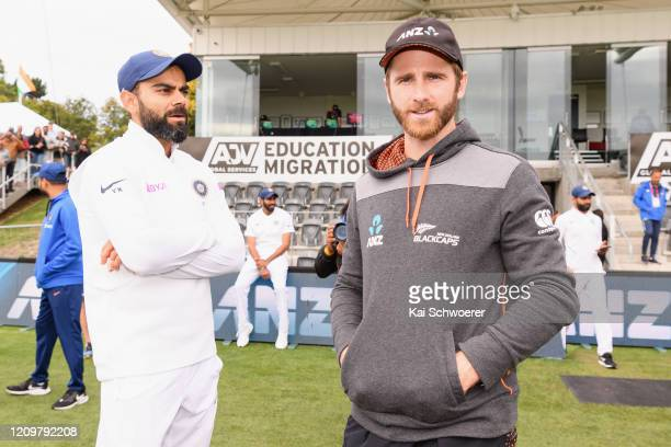 Captains Virat Kohli of India and Kane Williamson of New Zealand look on at the end of day three of the Second Test match between New Zealand and...