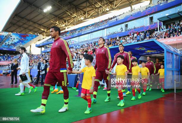Captains Yangel Herrera of Venezuela and Lewis Cook of England lead out their teams prior to the FIFA U20 World Cup Korea Republic 2017 Final between...