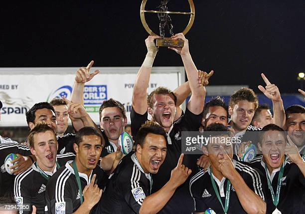 Captiain of the New Zealand U19 rugby team Chris Smith holds up the trophy surrounded by teammates 21 April 2007 after defeating South Africa during...