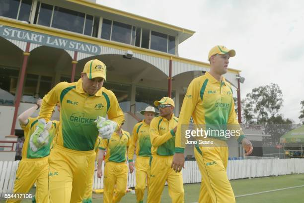 XI captian Beau Webster leads out his team during the JLT One Day Cup match between South Australia and the Cricket Australia XI at Allan Border...
