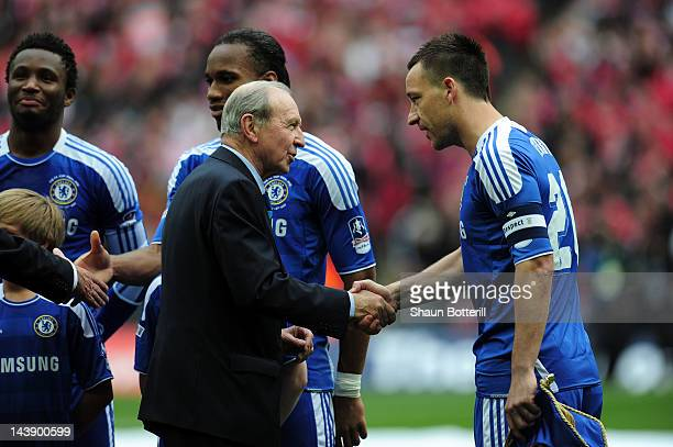 Captian John Terry of Chelsea shakes hands with Jimmy Armfield prior to the FA Cup with Budweiser Final match between Liverpool and Chelsea at...