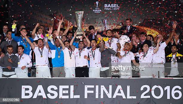 Captian Jose Antonio Reyes of Sevilla lifts the Europa League trophy as players celebrate at the award ceremoy after the UEFA Europa League Final...