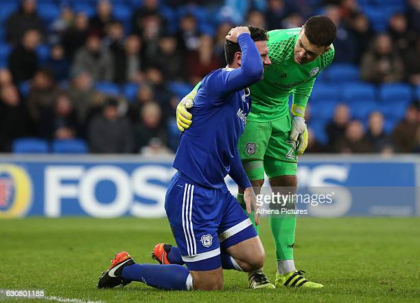 Captian Sean Morrison of Cardiff City holds his head after clashing with an Aston Villa player during the Sky Bet Championship match between Cardiff...