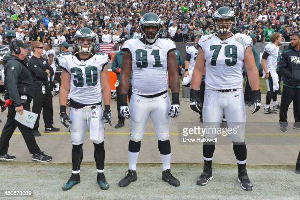 Captians Colt Anderson Fletcher Cox and Todd Herremans of the Philadelphia Eagles pose for a photograph before the game against the Oakland Raiders...