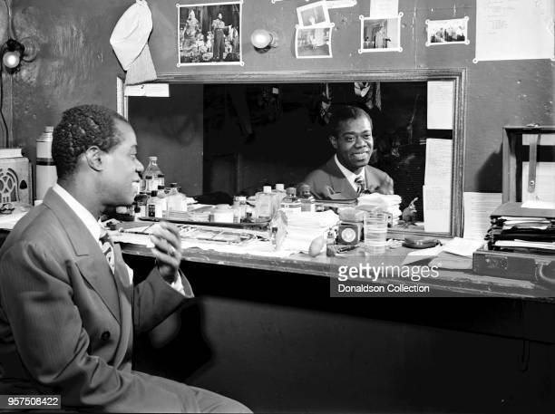 Caption from Down Beat: These are the things that make up Louis Armstrong, as reflected in the mirror by Bill Gottlieb, staff lensman, in the third...