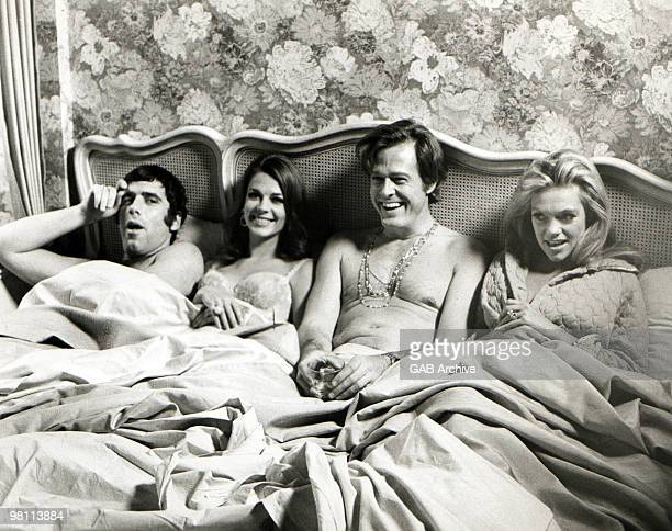 LR American actors Elliott Gould Natalie Wood Robert Culp and Dyan Cannon sit in bed together in a promotional still from the film 'Bob Carol Ted...