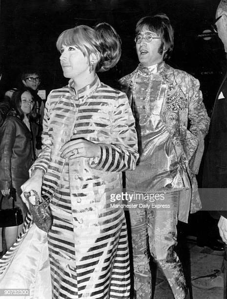 Caption reads 'How to stop the traffic John and Cynthia Lennon last night' John Lennon formed the Beatles in 1960 with Paul McCartney George Harrison...