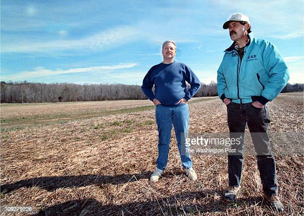 03/13/98 CaptionWayne Mc Bride and Mark Grace stand on unused farmland that they both hope will be the future home of little league baseball fields...