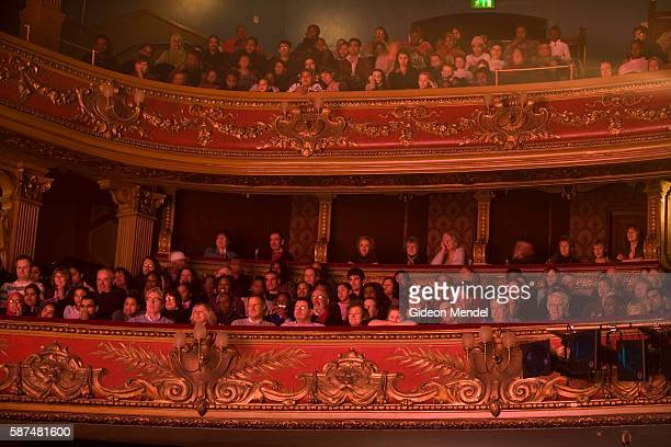 A captivated audience watches a performance of the pantomime Cinderella from the elaborately decorated stalls at the Hackney Empire Theatre It is a...