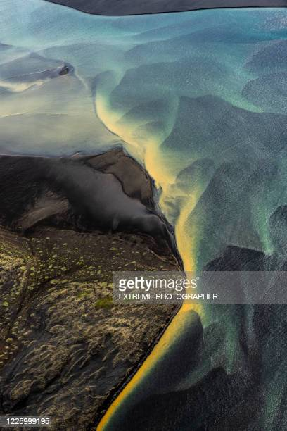 captivating beauty of curvy glacial rivers flowing through the iceland countryside, captured from a helicopter - geology stock pictures, royalty-free photos & images