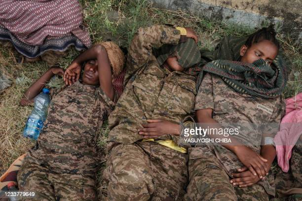 Captive Ethiopian female soldiers lie on the grass at Mekelle Rehabilitation Center in Mekele, the capital of Tigray region, Ethiopia, on July 2,...
