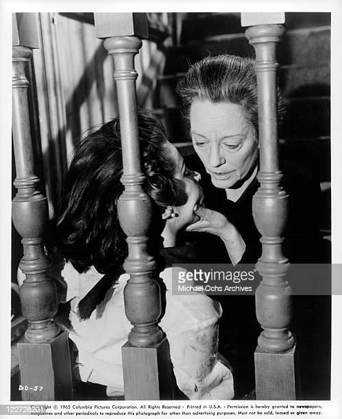 Captive Stefanie Powers has her head held by Tallulah Bankhead in a scene from the film 'Die Die My Darling' 1965