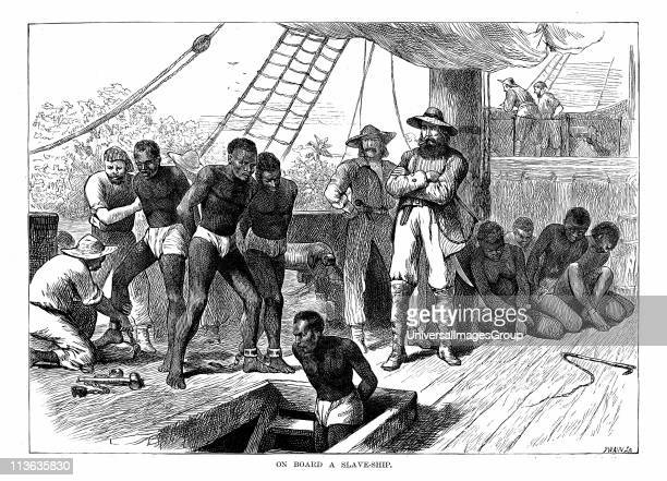 Captives being brought on board a slave ship on the West Coast of Africa Wood engraving c1880