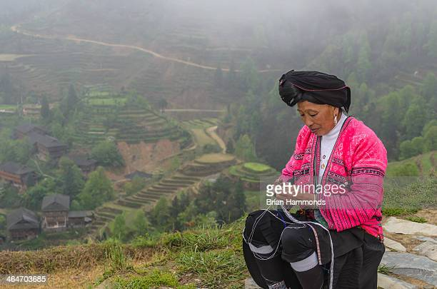 Capture of a long haired tribes woman near Guilin, China.
