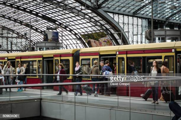 Capture of S-Bahn in Berlin, standing on platform in Berlin Central station. Some people are walking on platform, other people are waiting. At let...