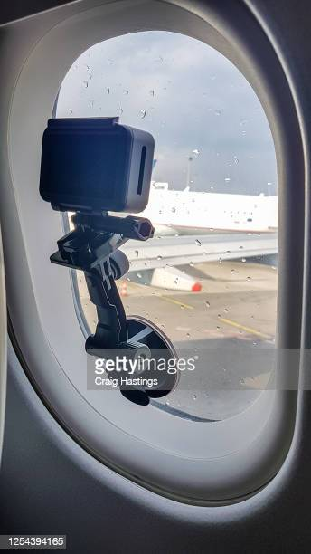 capture the moment. handheld camera mounted to the airplane window capturing a time-lapse of the vacation journey to have as memories - travel destinations stock pictures, royalty-free photos & images