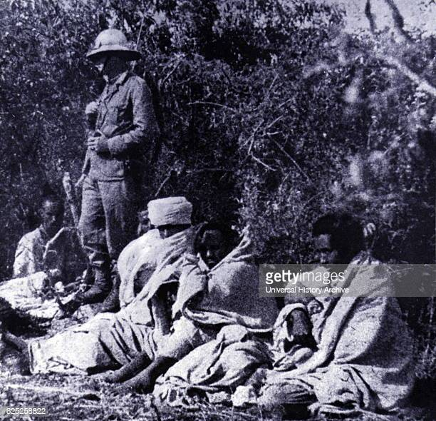 Captured Ethiopian soldiers gaurded by an Italian soldier during the Abbysinian War 1936